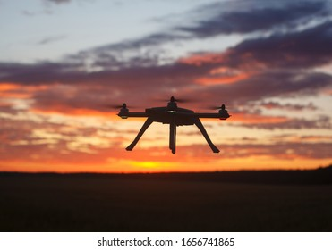 Drone in the sky during sunrise in vivid color