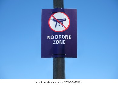 Drone in sky sign at Gatwick Airport flying not allowed or permitted air zone