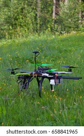 Drone is standing on a green grass in a summer day.
