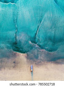 Drone of surfer by the water in Manhattan Beach