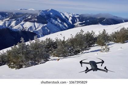 Drone taking off on a snowy landscape
