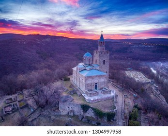 Drone top view on Patriarchal Cathedral of the Holy Ascension of God at sunrise in Medieval Stronghold Tsarevets,Veliko Tarnovo. Bulgaria