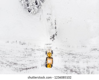 Drone top view snow removal excavator truck
