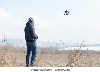 drone user piloting a drone