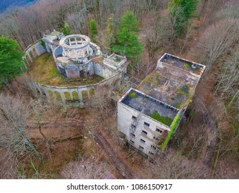 Drone view of the abandoned building of the former restaurant among the trees on the top of Mount Akhun in winter day, Sochi, Russia