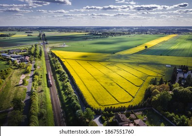 Drone view above railway tracks among fields in Rogow village, Lodz Province of Poland - Shutterstock ID 1867551760