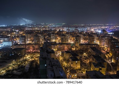 Drone view of a big city at night in the winter. Industrial sight on the background. Galati Nightscene
