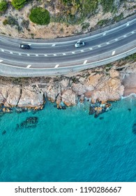 Drone view of cars on a coastline road near Mediterranean Sea in Barcelona, Spain