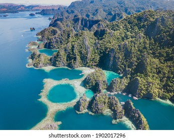 Drone view of Coron Islands in Palawan Philippines. Aerial view of islands surrounded by blue sea.