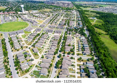 Drone view high above suburbia new modern complex Pflugerville , Texas real estate suburb with huge circle architecture design. Houses and homes living right outside Austin , TX