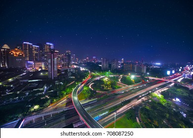 Drone view of Jakarta CBD cityscape area with Semanggi interchange highway at night