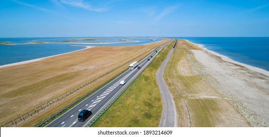 Drone view of the manmade dike between 'Enkhuizen' and 'Lelystad', the so-called 'Houtribdijk' right in the middle of the 'IJsselmeer' (IJssel lake), the Netherlands