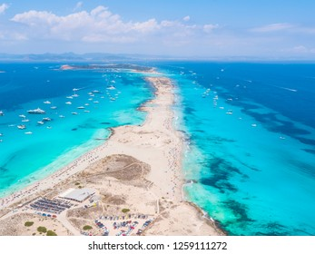 Drone view over the turquoise island of Formentera, Ibiza. With lots of yachts anchored off the coastline.