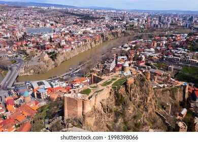Drone view of the residential areas of the city of Tbilisi, located on the banks of the Kura River and is the capital..of Georgia - Shutterstock ID 1998398066