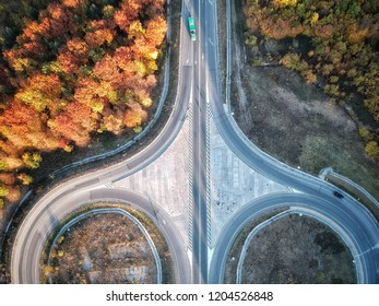 Drone view of roads at sunset in an autumn colourful day