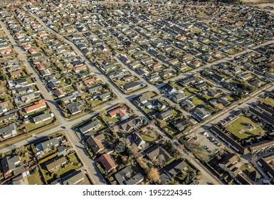 Drone view of suburban neighborhood - Shutterstock ID 1952224345