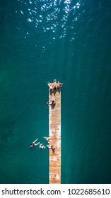 Drone view of water friends sitting on deck