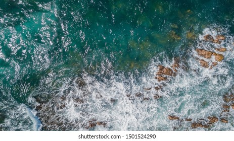 Drone view of waves hitting the rocks at Caye Chateau Saint Martin Sint Maarten