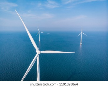 drone view of an wind mill farm, aerial view from the sky at windmill park in ocean at sea by the Netherlands