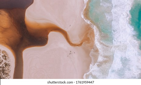 Drone view of Yeagarup Beach and the Warren River, Western Australia, wild southern ocean, river entrance, Australian coastline, rugged coast and crashing waves