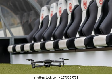 Drone waiting for take off in front of the players seats in the soccer stadium Commerzbank Arena in Frankfurt