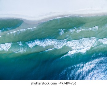 Drone/Aerial Photograph of the Gulf of Mexico washing ashore on the beautiful white sand beach of Gulf Shores/Fort Morgan, Alabama.  USA