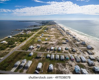 Drone/Aerial Photograph of Gulf Shores/Fort Morgan Alabama.  This area is known for its warm oceans and white sand beaches.