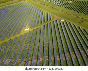 Droneshot from above of green electricity produced by solar panels in germany.