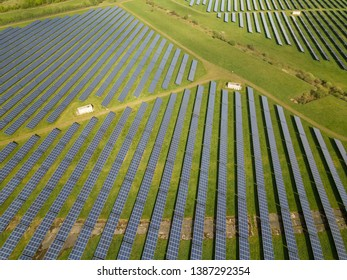 Droneshot of green electricity produced by solar panels in germany.