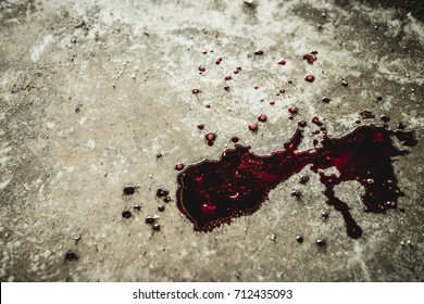 A drop of blood on a hunk of dirt in an abandoned house them. Background operators in Halloween festivities. The story about the murder