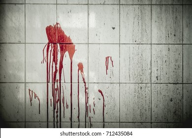 A drop of blood on a wall in an abandoned house them. Background operators in Halloween festivities. The story about the murder