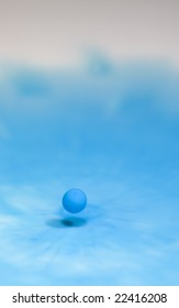 It is a drop of blue colored milk caught just before impact
