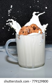drop cookie into glass of milk