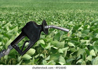 drop of fuel from a gasoline nozzle with soybean field in background