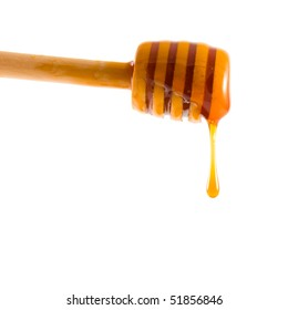 Drop of honey on a white background