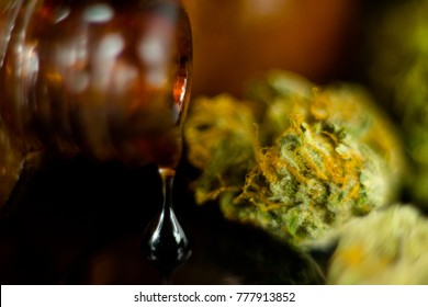 Drop of Medical Cannabis Oil in old brown glass original antique apothecary jar.