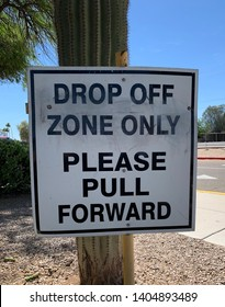 Drop Off Zone Only, Please Pull Forward sign on utility pole