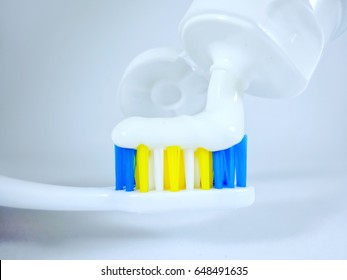 Drop toothpaste on toothbrush every morning.