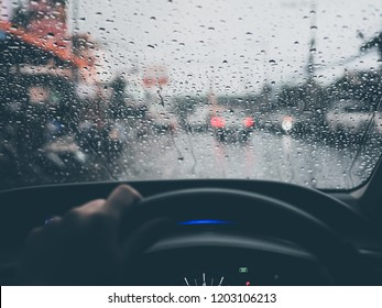drop water on the glass of a car