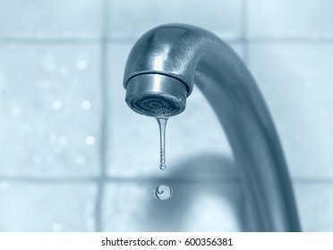 A drop of water from a tap close up