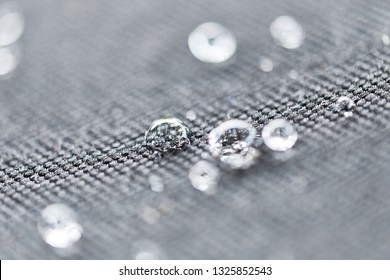 Droplet on soft top car roof. Water beading after rain or car wash on black fabric surface. Hydrophobic effect by ceramic coat which create high surface tension. Water drop Backgroud & texture.