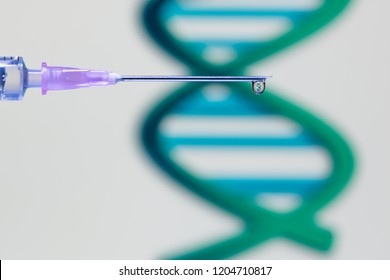 A droplet of vaccine at the tip of the needle and syringe reflecting a DNA structure