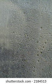 Droplets of condensation water on sheet of glass