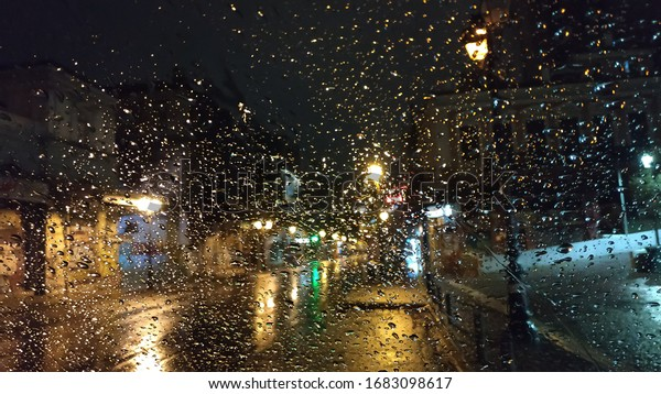 droplets-on-glass-rainy-night-600w-16830