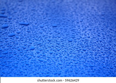 droplets of water on car