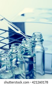Dropping chemical liquid to test tubes, laboratory research