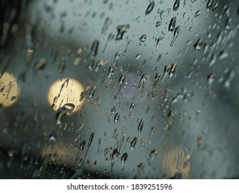 drops of autumn rain on the windshield of the car