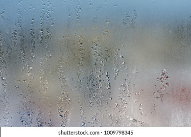 Drops of condensed steam on a transparent surface of glass or plastic. Texture of water
