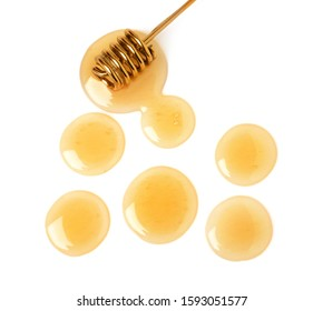 Drops of honey and dipper on white background, top view