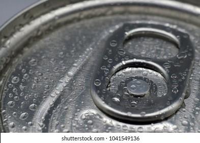 Drops on an aluminum can. Macro.
